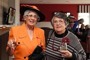 enjoying-some-fine-wine-min-aspiring-lifestyle-retirement-village-wanaka-new-zealand-min-min